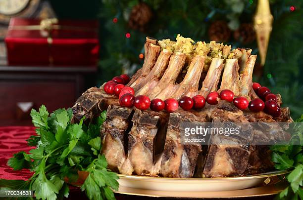 A Christmas crown roast of pork meal in festive background