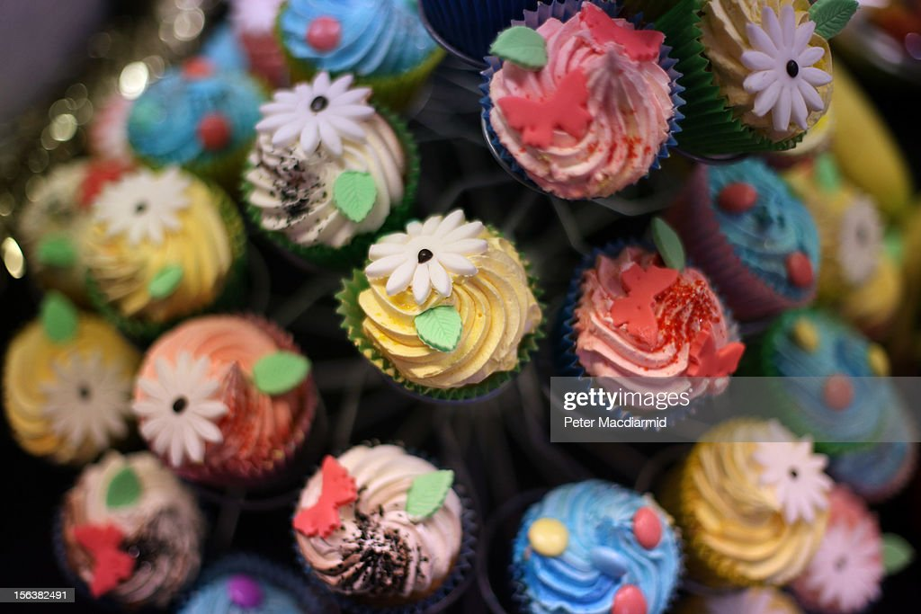 Christmas cup cakes are displayed for sale at The Ideal Home Christmas Show on November 14, 2012 in London, England. Over 400 exhibitors are showcasing a range of gift ideas for Christmas at the Earls Court exhibition centre.