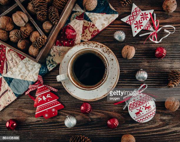 Christmas Decor with Cup of Coffee on Dark Wooden Background
