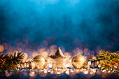 Decorative christmas still life. Abstract christmas trees on gold and blue glitter background.