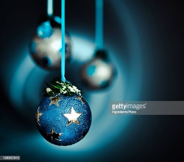 Christmas decoration in snow on dark background blue silver series