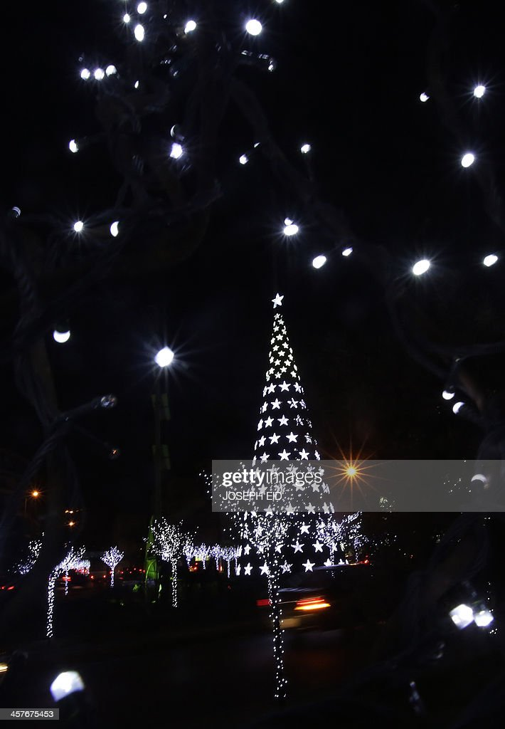 Christmas decoration lights up the Christian suburb of Sin El-Fil on the eastern outskirts of the Lebanese capital Beirut on December 18, 2013.