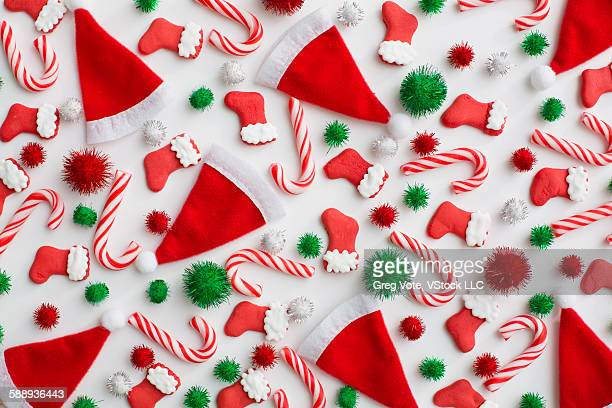 Christmas decoration of santa hats, candy canes and Christmas stockings
