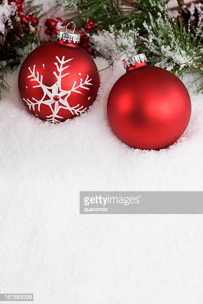Christmas Decoration of Two Red Ornaments on Snow, Copy Space