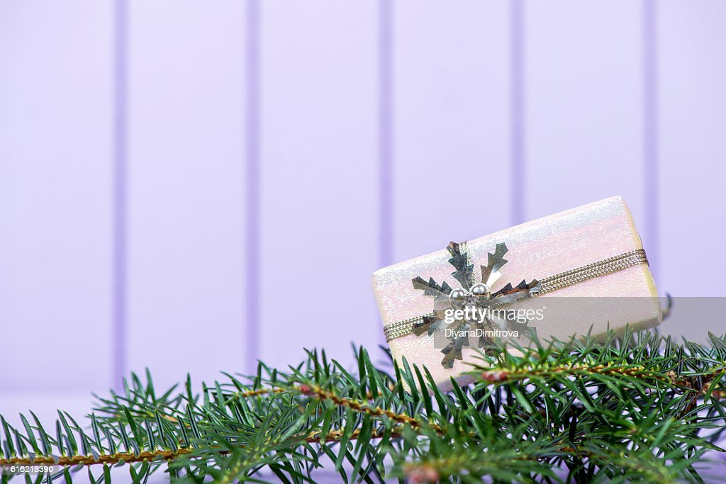 Christmas decoration on a purple striped background - selective : Stock Photo