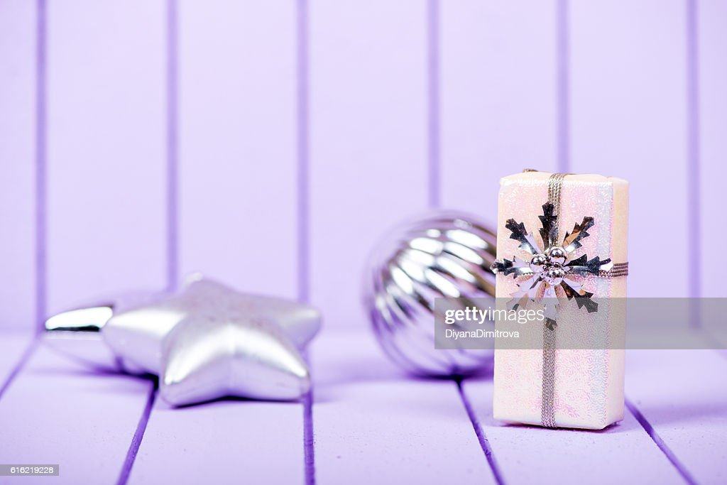 Christmas decoration on a purple striped background - selective : Stock-Foto