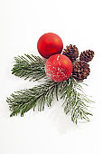 Christmas decoration with Christmas bauble and fir twigs, close-up