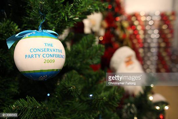 Christmas decorations and baubles with 'Conservative Party Conference 2009' printed on them are displayed for sale in the exhibition hall ready for...