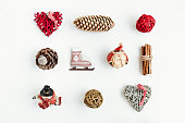 Christmas decorations and objects for mock up template design. Christmas gift box, christmas hearts, cinnamon, cones, ice skating View from above. Flat lay. Xmas decorations.