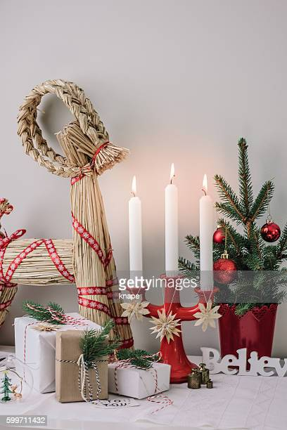 Christmas decorations and wrapped gifts in candle light