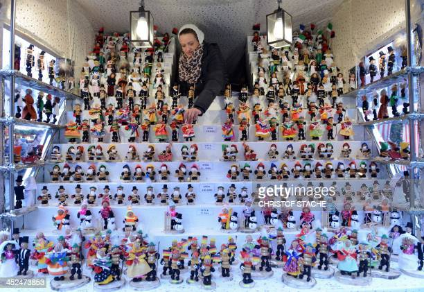 Christmas decorations are for sale at a stand of the traditional Christmas Market in Nuremberg southern Germany on November 29 2013 The traditional...