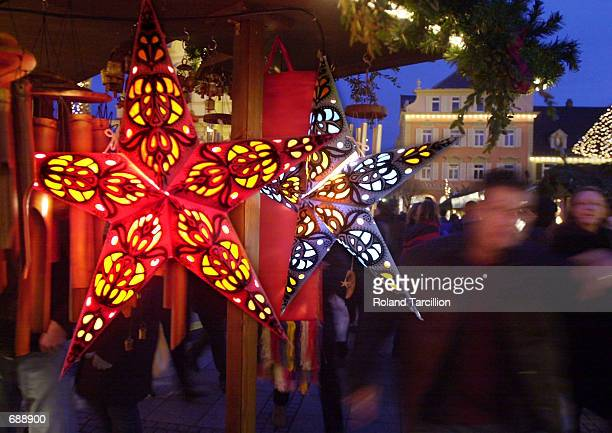 Christmas decorations are hung on a stall at a Christmas Market December 23 2001 near Stuttgart Germany Thousands flock to the Christmas markets at...