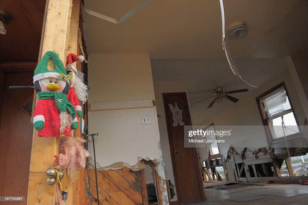 Christmas decorations are put up on a house devastated by Superstorm Sandy a month prior on December 5, 2012 in Union Beach, New Jersey. With a population of 6,200, roughly 1,000 homes were flooded and 200 rendered inhabitable.