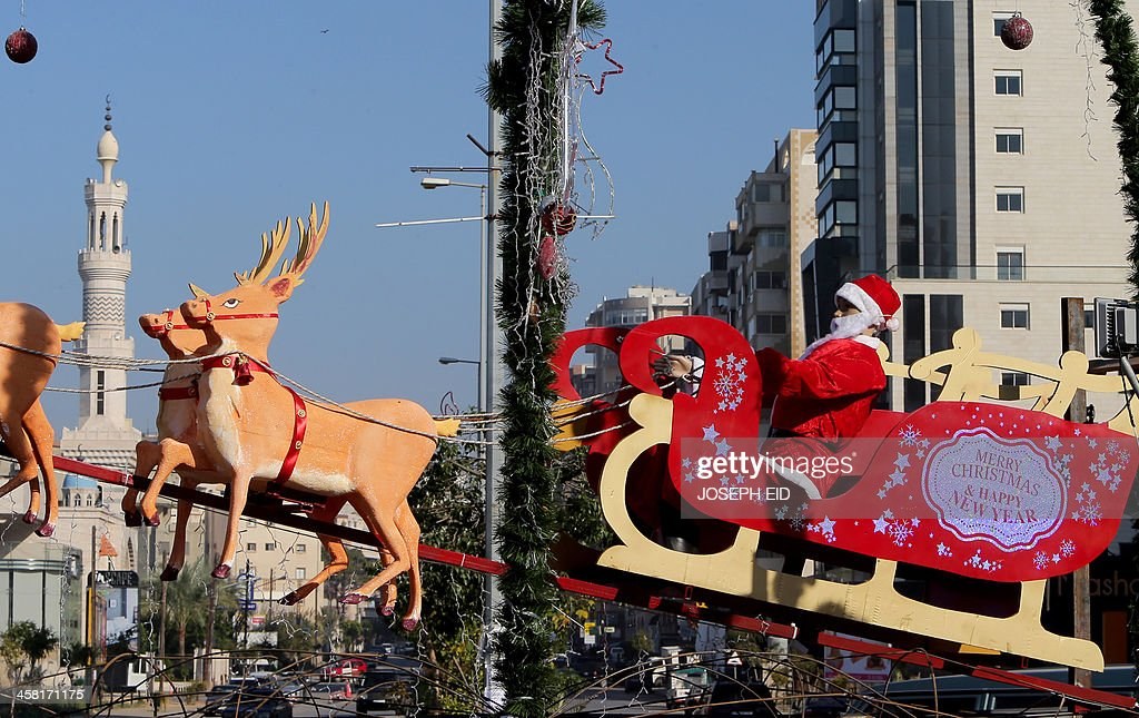 Christmas decorations are seen at a roundabout in the northern Lebanese coastal city of Tripoli on December 20, 2013.