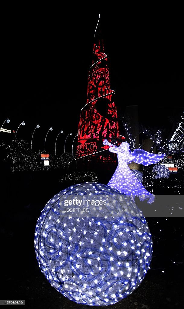 Christmas decorations are seen at the Lebanese historical coastal city of Byblos on December 16, 2013. Pope Francis II said via Twitter ' We cannot resign ourselves to think of a Middle Eat without Christians. Let us pray every day for peace.