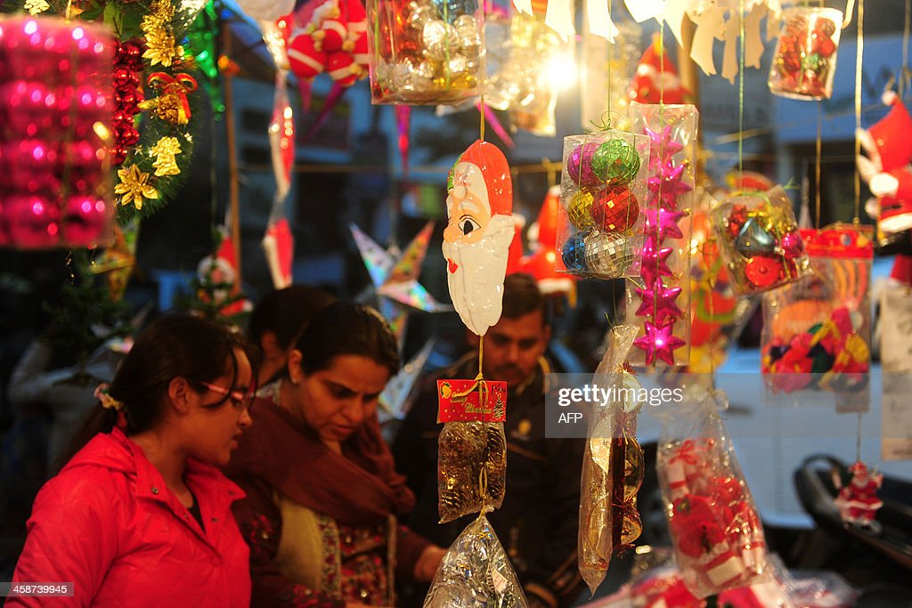 Christmas decorations are seen for sale at a roadside stall ahead of the holiday season in Allahabad on December 21 2013 Despite Christians forming a...
