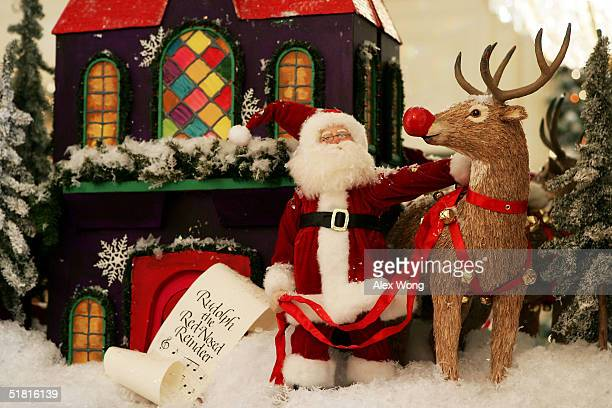 Christmas decorations are seen in the East Room during a press preview of the White House Christmas decorations December 2 2004 in Washington DC The...