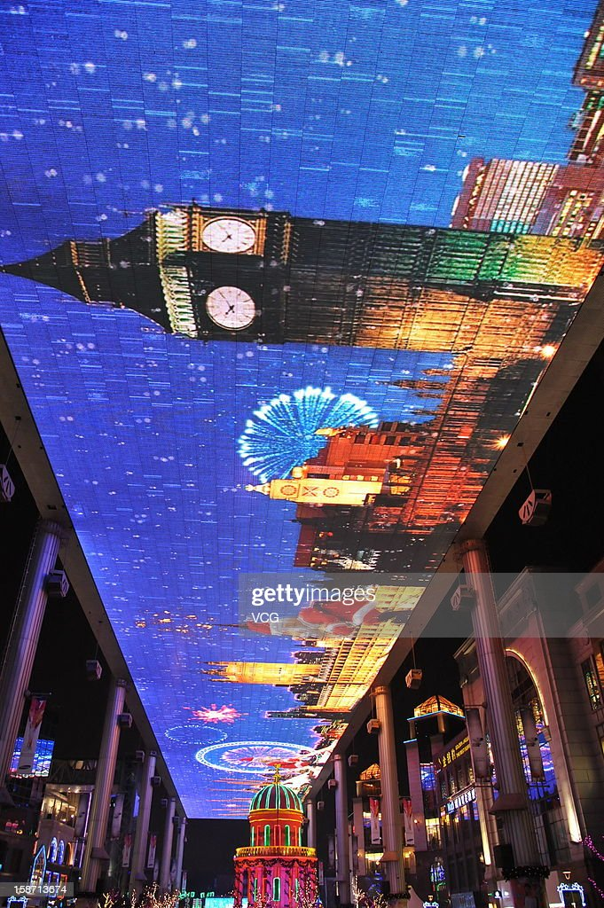 Christmas decorations are seen under the World's second largest LED screen at The Place on December 25, 2012 in Beijing, China.