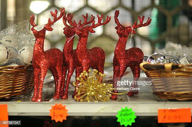 Christmas decorations for sale on market stalls on December 16 2013 in London England New Covent Garden Flower Market is London's premier wholesale...