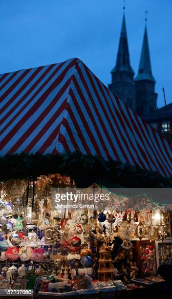 Christmas decorations hang for sale at a stand at the traditional Christmas market 'Nuernberger Christkindlesmarkt' ahead of the opening ceremony on...