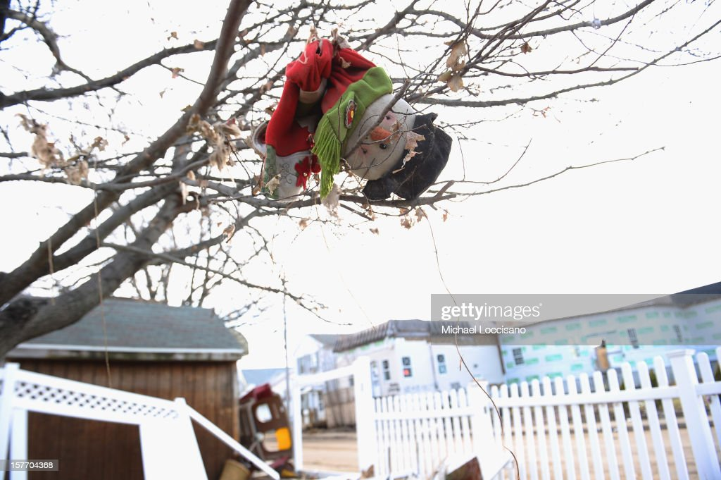 Christmas decorations hang from a tree in front of a house devastated by Superstorm Sandy a month prior on December 5, 2012 in Union Beach, New Jersey. With a population of 6,200, roughly 1,000 homes were flooded and 200 rendered inhabitable.