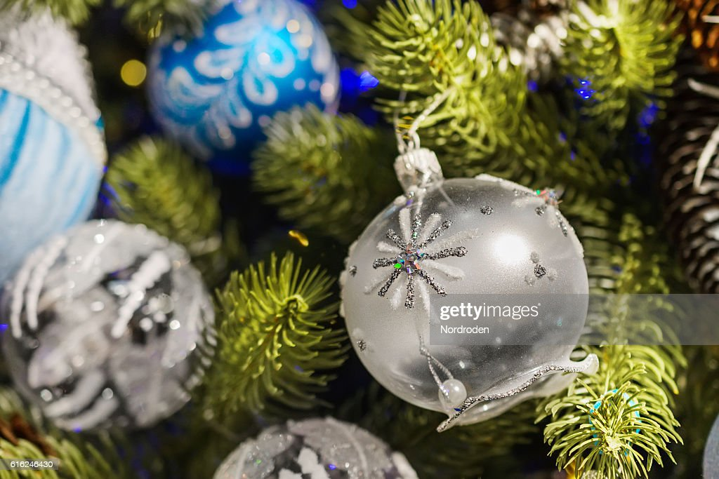 Christmas decorations on artificial fir. : Stock-Foto
