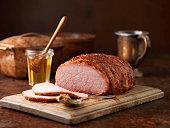 Christmas dinner. Honey and wholegrain mustard gammon on chopping board