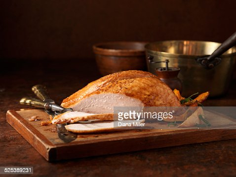 Christmas dinner. Organic roasted turkey breast on chopping board