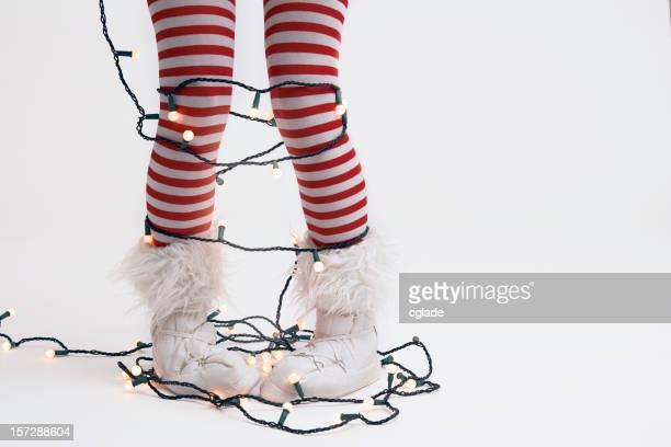 Christmas Elf Hanging the Lights