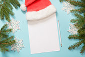 Christmas empty blank letter for Santa Claus with milk, cookies. Top view and space for your text. Flat lay. Top view.