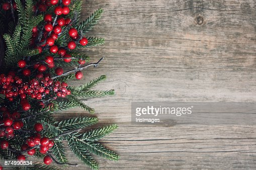 Christmas Evergreen Branches and Berries Over Wood : Stock Photo