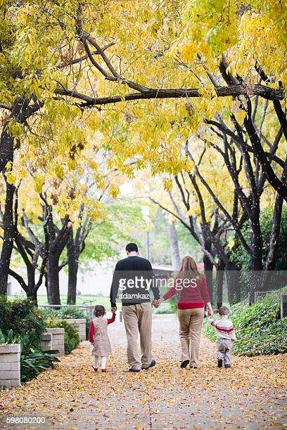 Christmas Family Walking Under Trees