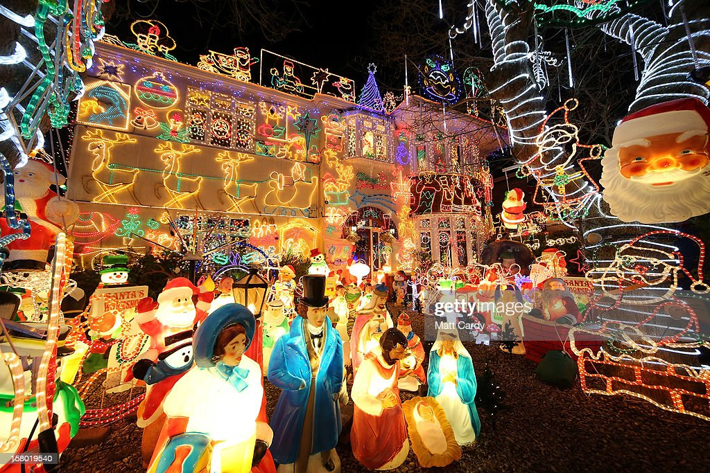 Christmas festive lights adorn a detached house in a suburban street in Melksham, December 8, 2012 in Melksham, England. The lights, a popular festive attraction, have returned to the town after a two-year absence and have raised thousands of pounds for charity for a local hospice, Dorothy House. The display, which is estimated to involve over 100,000 bulbs, worth over 30,000 GBP and even needed a up rated electricity supply installed to cope with the additional power needed, is the brainchild of householder and electrician Alex Goodhind. This year, the display which Mr Goodhind began in fifteen years ago, now takes a team of professional electricians five weeks to complete, even includes a snow machine.