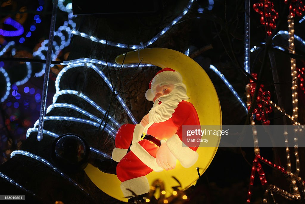 Christmas festive lights adorn a detached house in a suburban street in Melksham, December 8, 2012 in Melksham, England. The lights, a popular festive attraction, have returned to the town after a two-year absence and have raised thousands of pounds for charity for a local hospice, Dorothy House. The display, which is estimated to involve over 100,000 bulbs, worth over 30,000 GBP and even needed an up-rated electricity supply installed to cope with the additional power needed, is the brainchild of householder and electrician Alex Goodhind. This year, the display which Mr Goodhind began fifteen years ago now takes a team of professional electricians five weeks to complete, and even includes a snow machine.