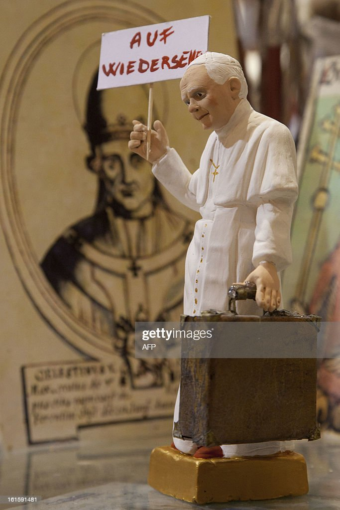 A Christmas figurine depicting Pope Benedict XVI holding a placard reading in German 'Goodbye' is displayed in the shop of craftman Gennaro Di Virgilio in Via San Gregorio Armeno on February 12, 2013. Pope Benedict XVI will bid his followers farewell in a final audience in St Peter's Square on February 27, the day before he officially steps down, a Vatican spokesman said.
