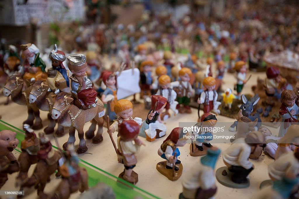 Christmas figurines of the traditional spanish Three Magic Kings and shepherds 'cagones' stand on a table fulled of figurines at a shop in a Christmas market fair at Plaza Mayor Square six days before Christmas Day on December 19, 2011 in Madrid, Spain. This year businesses are starting sales and discounts before Christmas to try and gain customers during the current economic crisis.