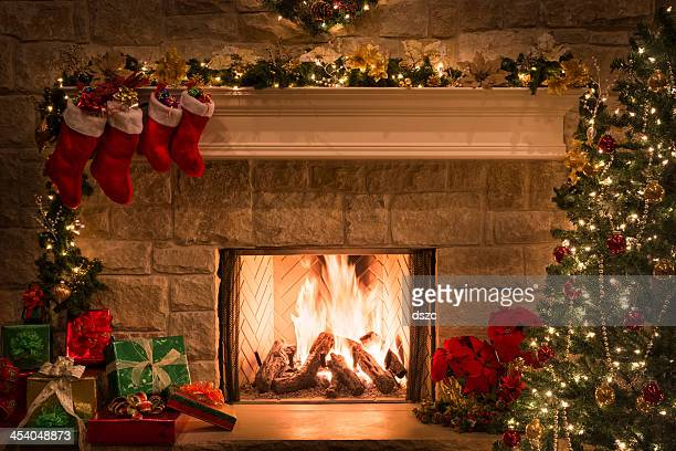 Christmas fireplace, stockings, gifts, tree, copy space