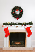 christmas fireplace with santa socks and wreath