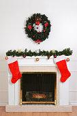 christmas fireplace with santa socks and wreath
