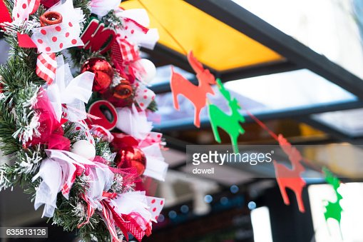 Christmas flowers and elks hanging outside of modern Shopping mall : ストックフォト