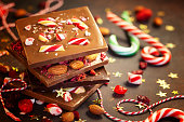 Christmas chocolate bark with peppermint,dried berries and nuts.