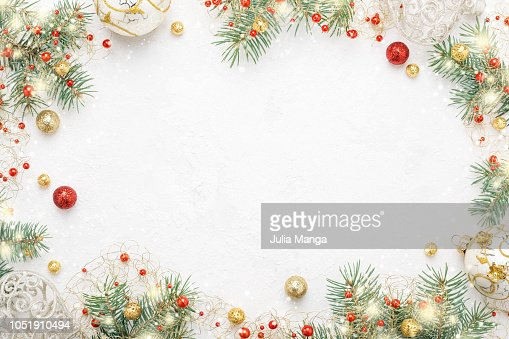 Christmas frame of spruce, red & gold christmas decorations on white space. : Foto de stock