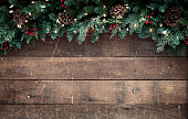 Christmas garland on an old wood background with copy space