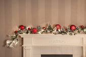 a christmas garland / sitting on a mantlepiece / looking all festive