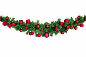 Christmas garland with red baubles.  Isolated on white.