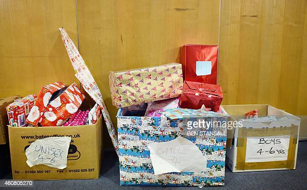 Christmas gift donations are collected together at a foodbank charity in west London on December 23 2014 Food bank use in Britain is growing rapidly...