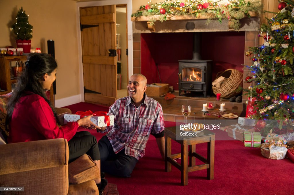 Christmas gift giving stock photo getty images christmas gift giving stock photo negle Images