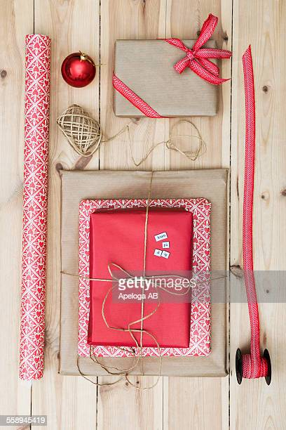 Christmas gift packages on wooden floor