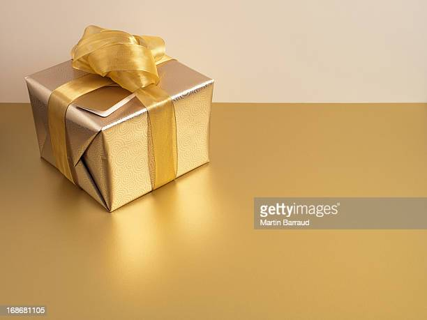 Christmas gift with gold ribbon and gold wrapping
