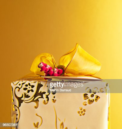 Christmas gift with gold ribbon : Stock Photo